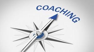 Bild eines Kompass, der in Richtung Coaching zeigt